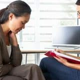 woman-having-counselling-session-female-counsellor-31172489.jpg